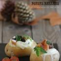 Patata rellena de brandada de bacalao, setas y crema de ajo.